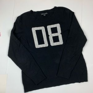 Long sleeve sweater with sparkle embellishments
